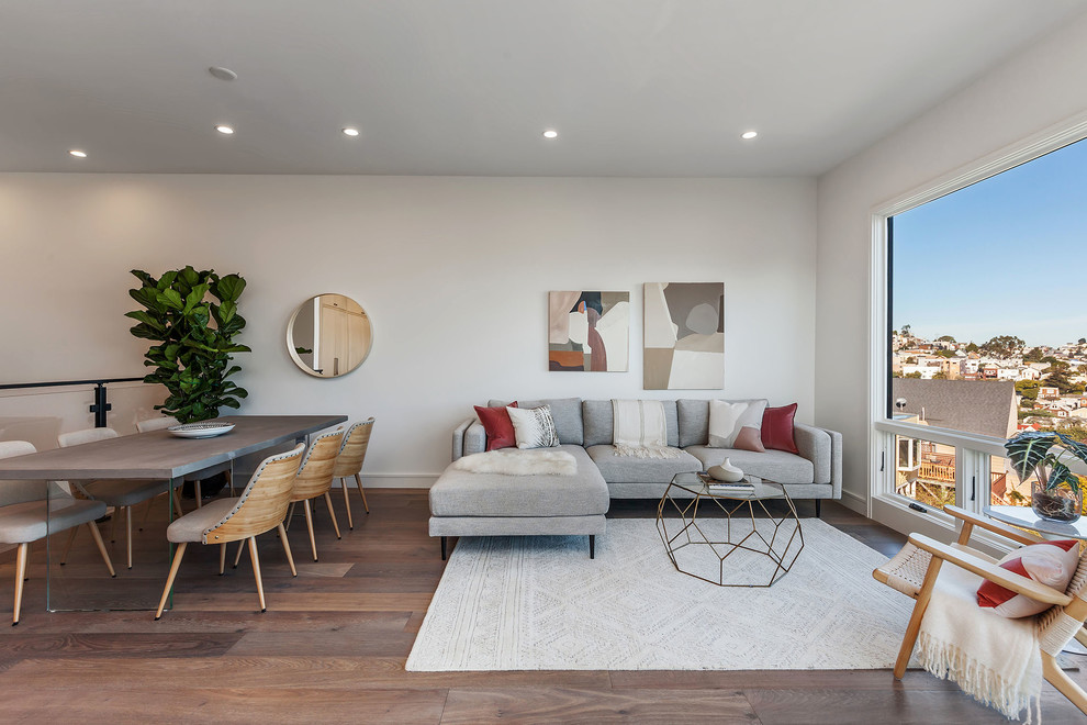 Trendy formal and open concept dark wood floor and brown floor living room photo in San Francisco with white walls, no fireplace and no tv