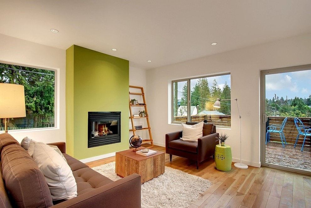 Inspiration for a contemporary living room remodel in Seattle with green walls