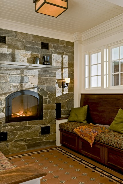 Reading nook with masonry heater and encaustic tile floor Reading nook in living room