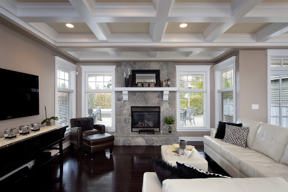 Example of a trendy living room design in Vancouver with a stone fireplace