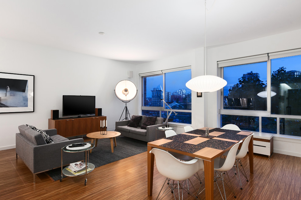 Example of a minimalist living room design in Vancouver with white walls