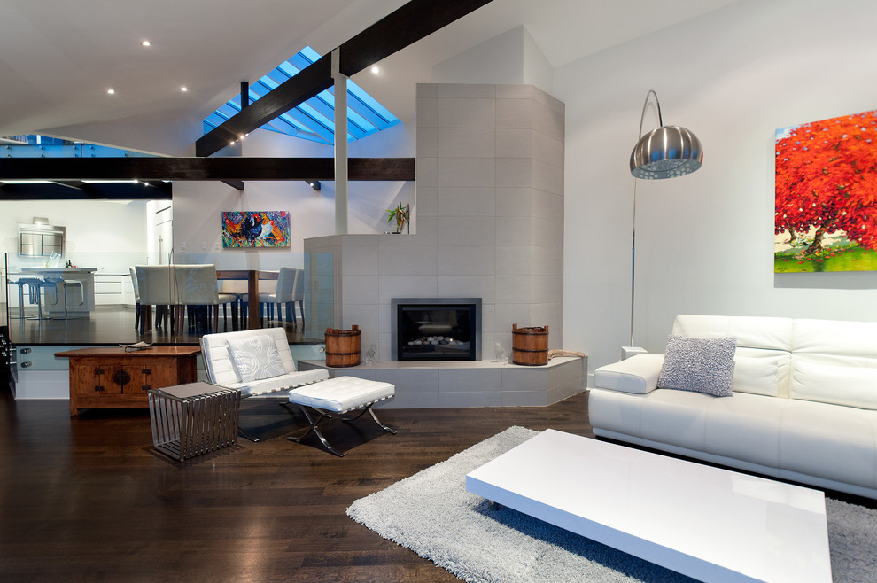 Example of a trendy living room design in Vancouver with white walls and a corner fireplace