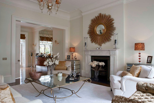 whatever fireplace ideas you use, make sure what's above the mantel balances with the size of the fireplace
