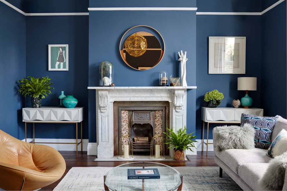 Living room - large contemporary formal dark wood floor living room idea in London with blue walls, no tv and a wood stove