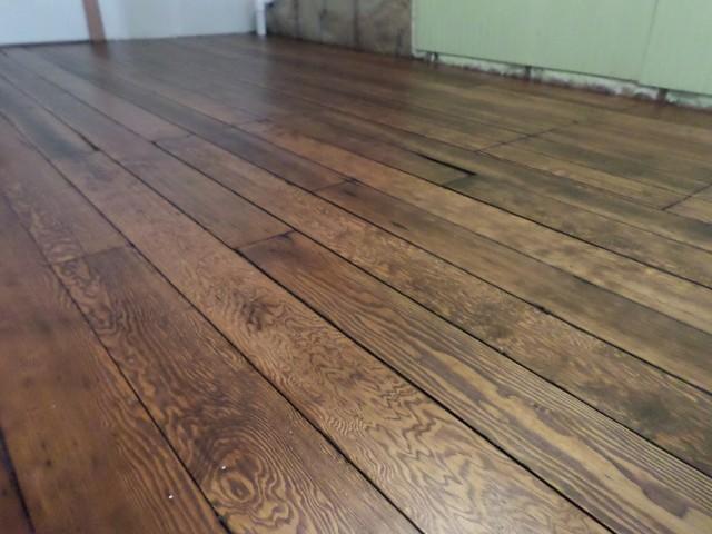Reclaimed hardwood floor rustic living room denver for Wooden flooring dealers