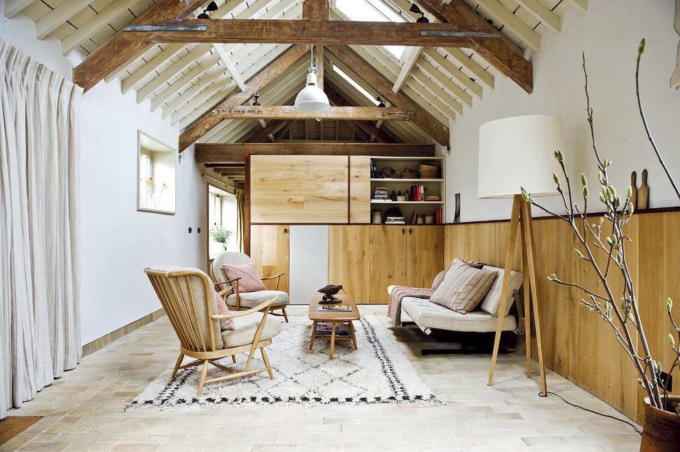 Living room - mid-sized scandinavian living room idea in London with white walls