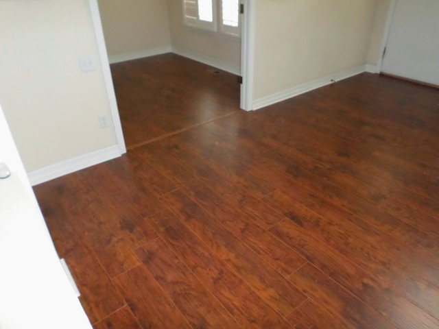 Red mahogany wide plank floor traditional living room for Hardwood floors denver