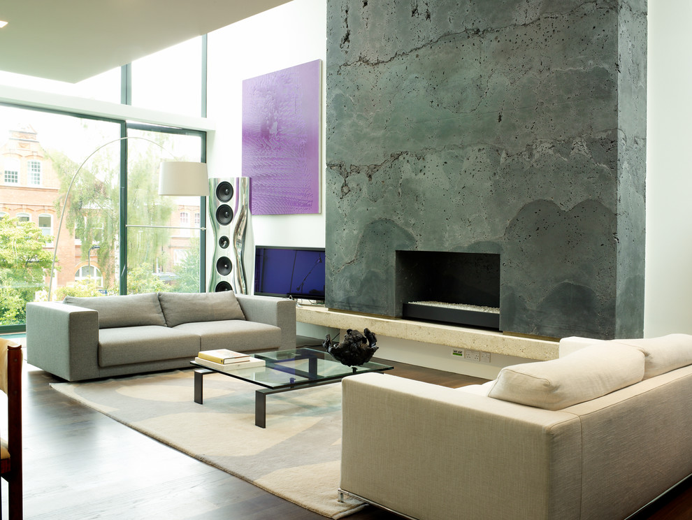 Inspiration for a contemporary open concept medium tone wood floor living room remodel in London with a standard fireplace, a concrete fireplace and a tv stand
