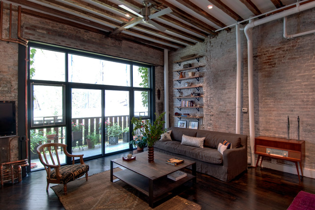 Inspiration for an industrial living room in New York with dark hardwood flooring.