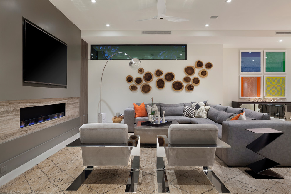 Living room - large contemporary open concept porcelain floor living room idea in Miami with gray walls, a ribbon fireplace and a wall-mounted tv