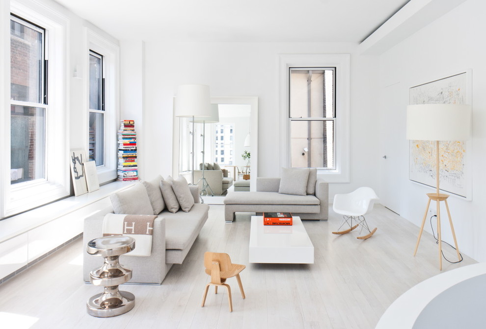 Inspiration for a scandinavian light wood floor and white floor living room remodel in New York with white walls and no fireplace