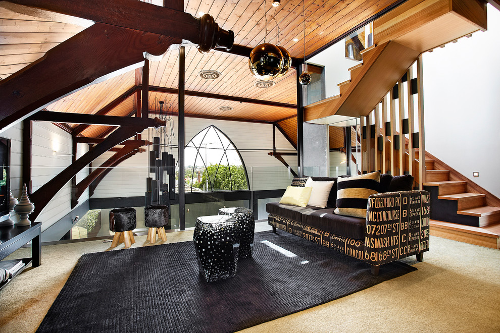 Living room - mid-sized contemporary loft-style carpeted living room idea in Melbourne with a tv stand and white walls
