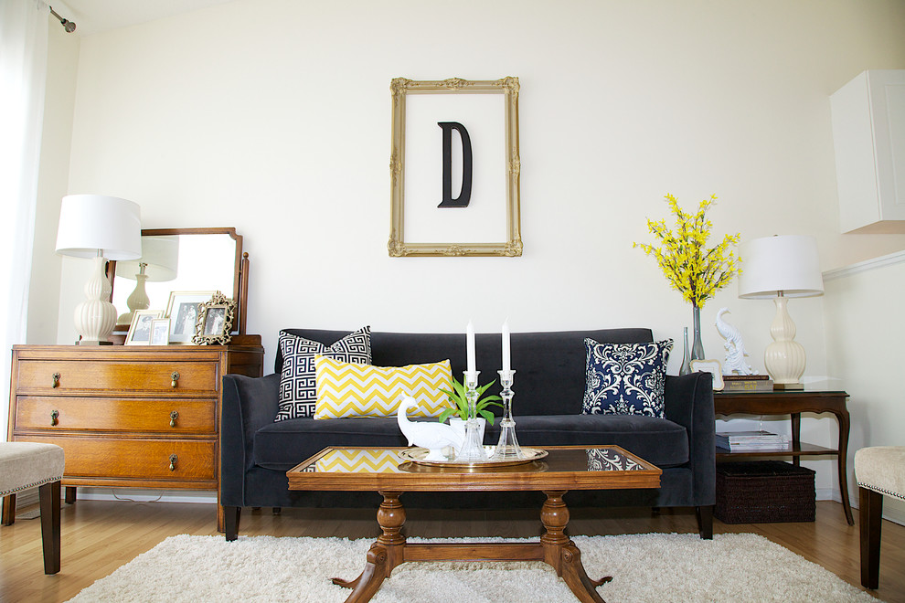 Example of a mid-sized trendy medium tone wood floor living room design in Other with white walls