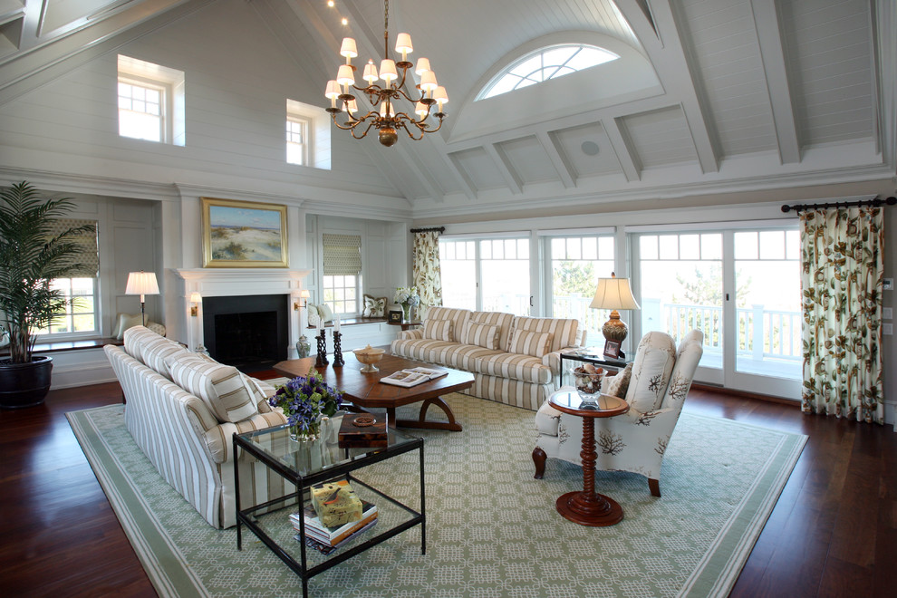 Living room - huge traditional formal and open concept medium tone wood floor living room idea in Philadelphia with white walls, no tv and a standard fireplace