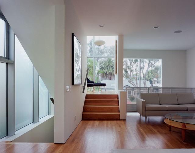 Minimalist open concept living room photo in Los Angeles with white walls