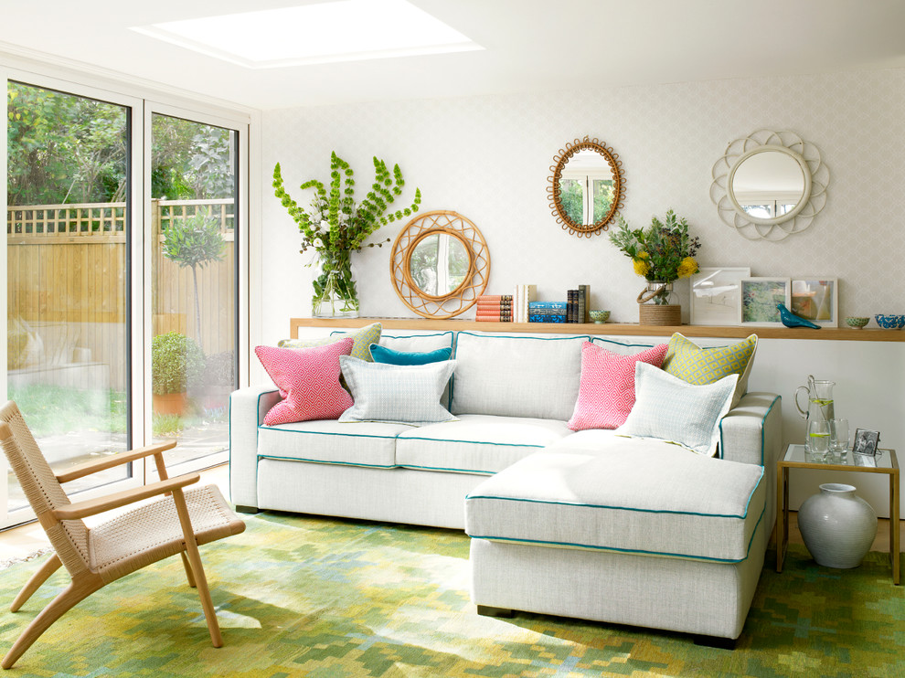 Example of a trendy green floor living room design in London with white walls