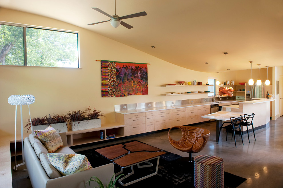 Example of a trendy formal and open concept concrete floor living room design in Austin with yellow walls