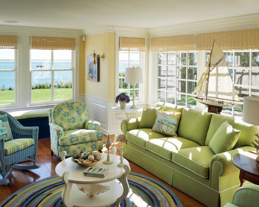 Living room - coastal medium tone wood floor living room idea in Boston with yellow walls