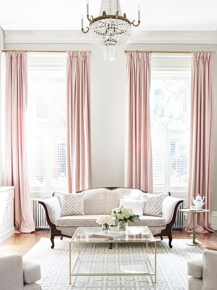 Example of a classic medium tone wood floor living room design in Philadelphia with white walls