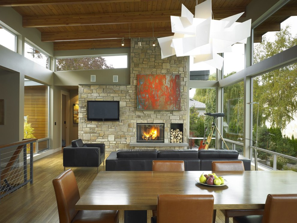 Example of a trendy living room design in Seattle with a stone fireplace