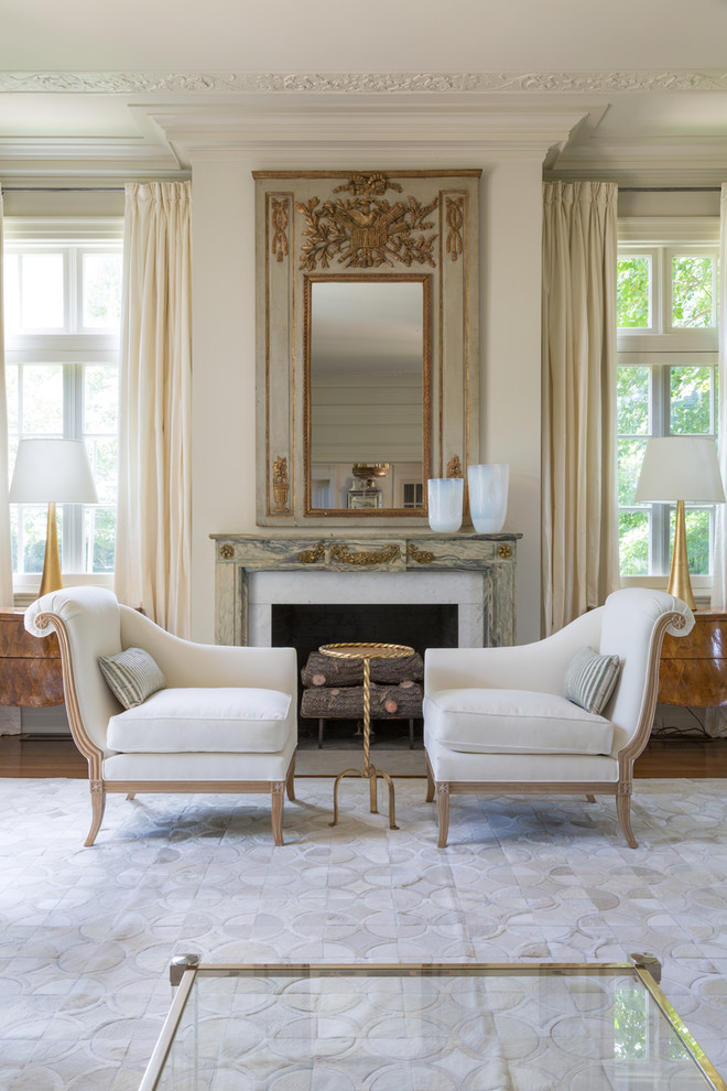Inspiration for a timeless formal dark wood floor living room remodel in New Orleans with white walls, a standard fireplace and no tv