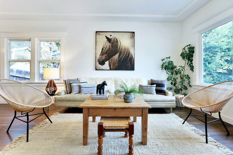Example of a transitional living room design in Los Angeles with white walls