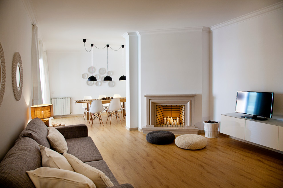 Example of a transitional living room design in Other with white walls