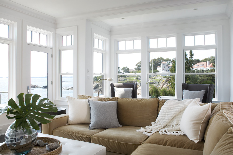 Example of a transitional living room design in Boston with white walls