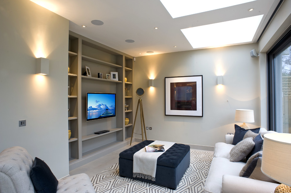 Inspiration for a transitional living room remodel in London with gray walls and a wall-mounted tv
