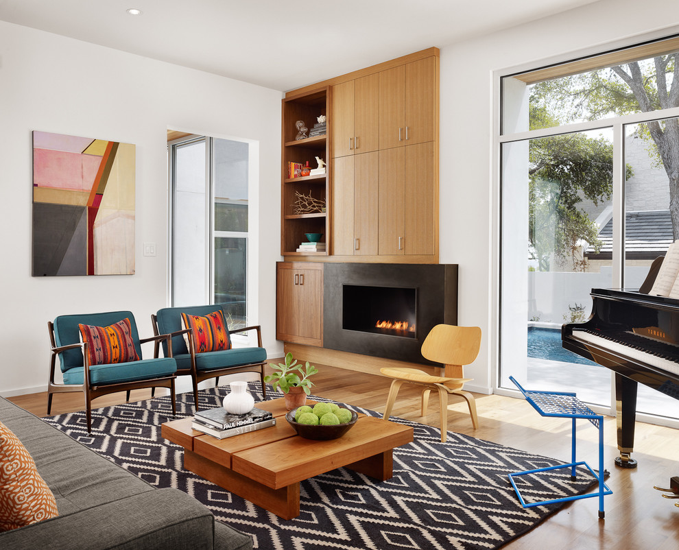 Example of a trendy living room design in Austin with a music area and a ribbon fireplace