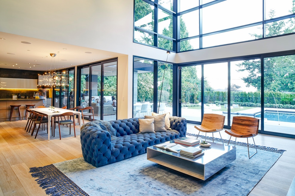 Mid-sized trendy open concept and formal light wood floor living room photo in Vancouver with white walls