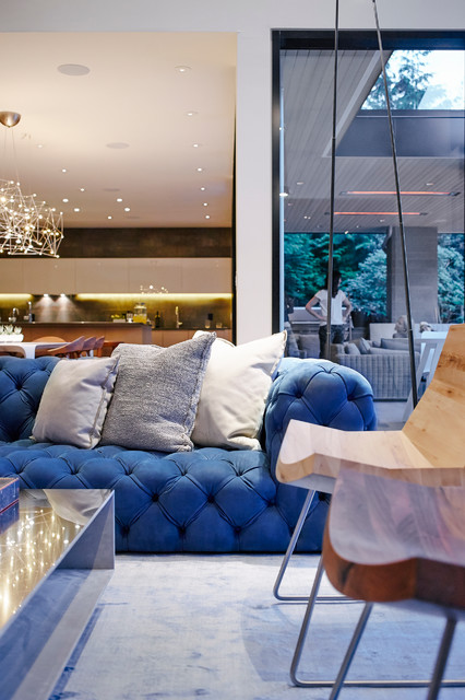 Example of a mid-sized trendy open concept light wood floor living room design in Vancouver with white walls, a standard fireplace, a concrete fireplace and a media wall