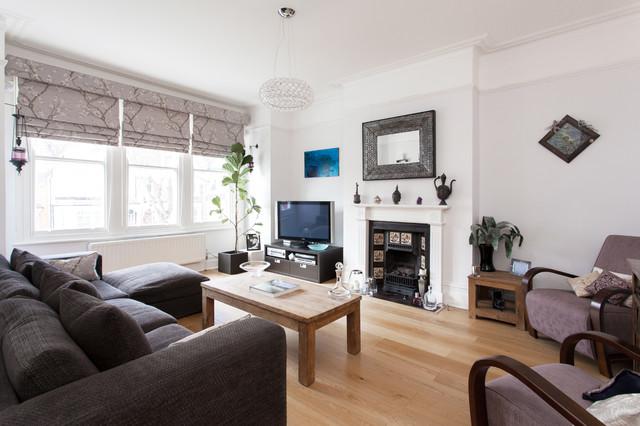 Scandinavian Light Wood Floor Living Room Idea In London With White Walls A Standard Fireplace