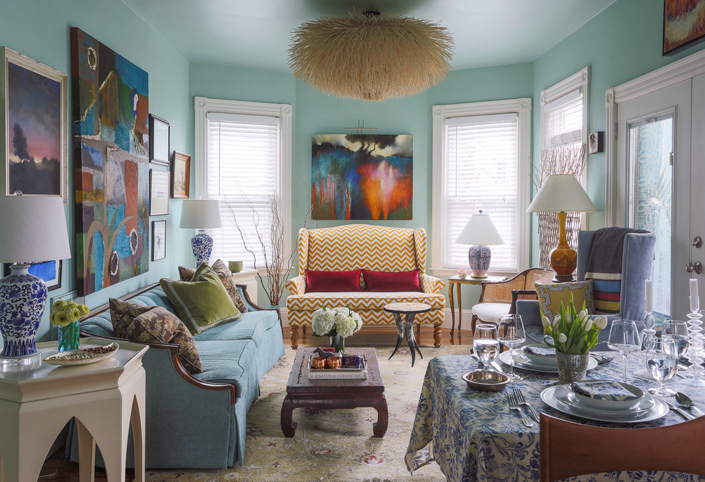 Mid-sized eclectic formal and open concept medium tone wood floor living room photo in Boston with no tv, blue walls and no fireplace