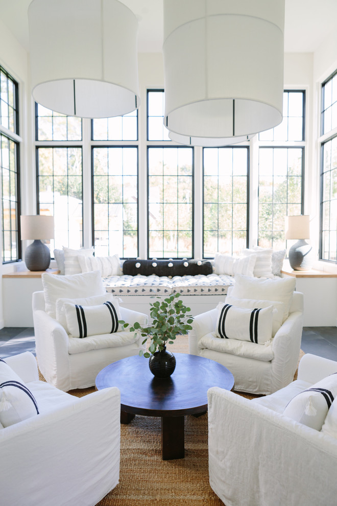 Inspiration for a coastal gray floor living room remodel in Nashville with white walls