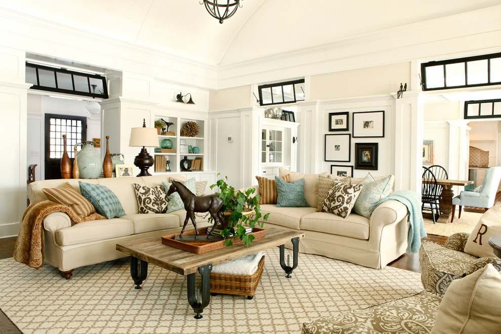 Elegant living room photo in New York with beige walls