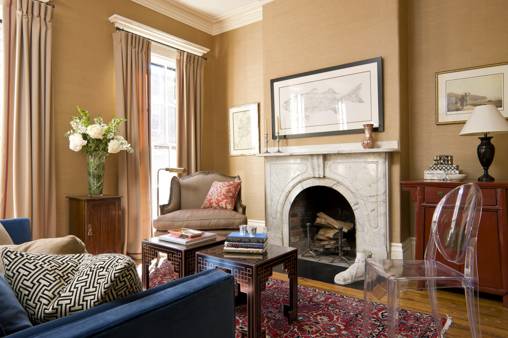 Living room - eclectic living room idea in Boston with beige walls and a standard fireplace