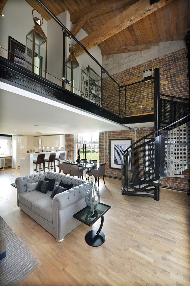 Inspiration for a large industrial light wood floor living room remodel in London with white walls, no fireplace and no tv