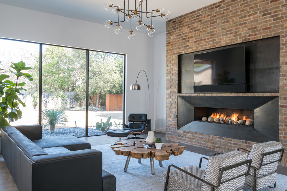 Trendy enclosed medium tone wood floor living room photo in Dallas with white walls, a ribbon fireplace, a metal fireplace and a wall-mounted tv