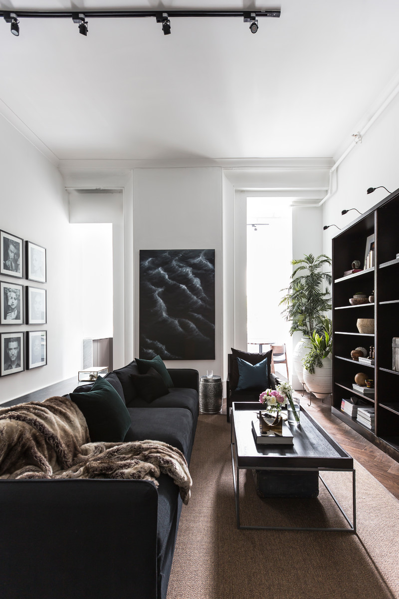 Inspiration for a small contemporary formal and open concept dark wood floor and brown floor living room remodel in Sydney with white walls, no fireplace and a tv stand