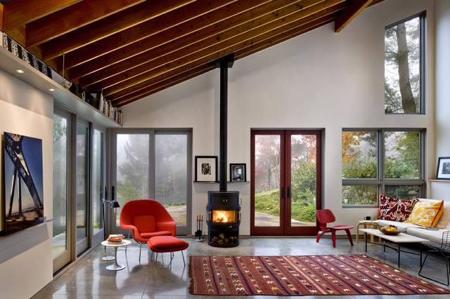 Trendy Concrete Floor Living Room Photo In San Francisco With A Wood Stove