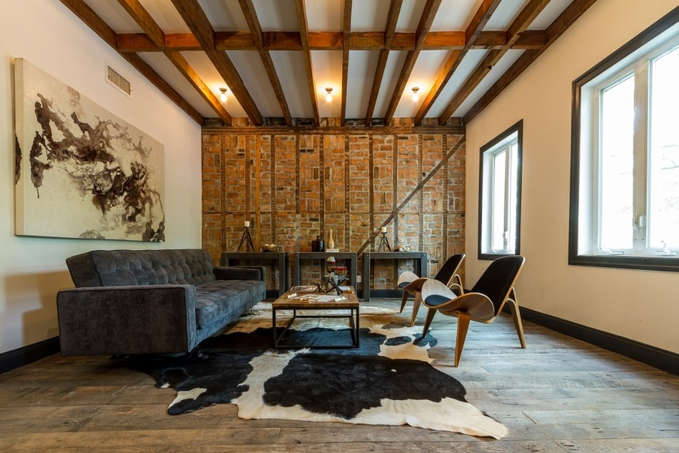 Inspiration for a contemporary open concept medium tone wood floor living room remodel in New York with white walls