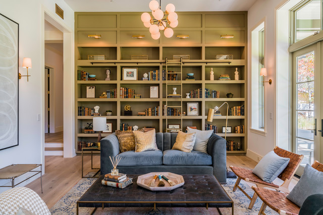 Living room - transitional medium tone wood floor and brown floor living room idea in Los Angeles with white walls