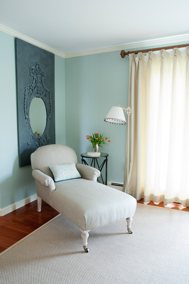 Example of an eclectic living room design in Boston with blue walls