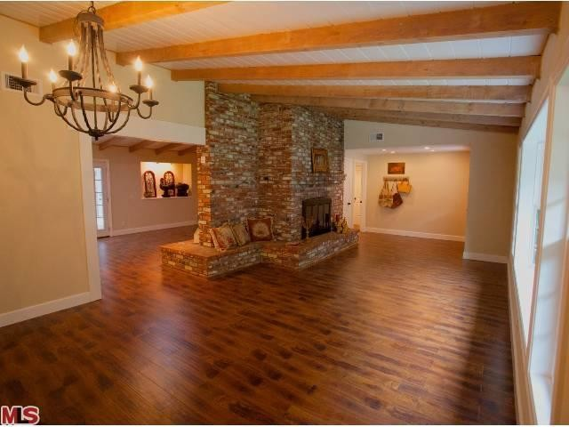 Rustic cottage renovation living dining area after for Interior designers in my area