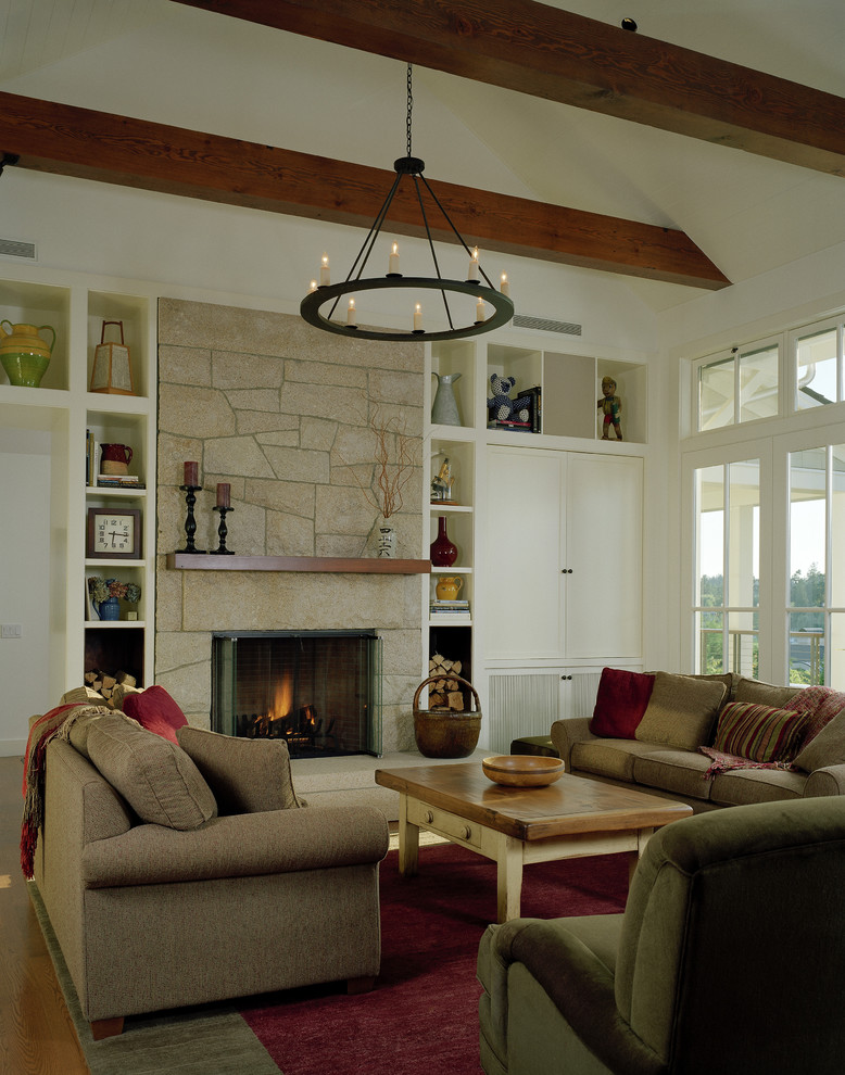 Example of a mountain style living room design in Seattle with a stone fireplace