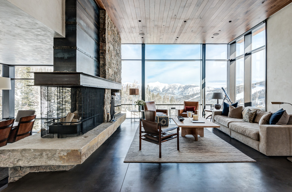 Living room - rustic concrete floor living room idea in Other with a two-sided fireplace