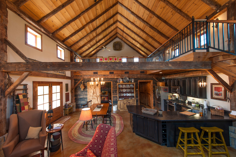 Inspiration for a rustic open concept living room remodel in Austin