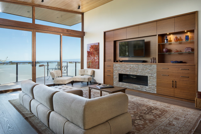 Example of a trendy formal and open concept medium tone wood floor and brown floor living room design in San Francisco with beige walls, a ribbon fireplace, a stone fireplace and a wall-mounted tv