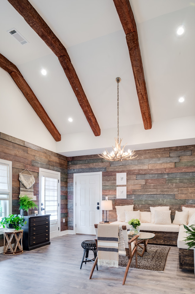 Inspiration for a mid-sized transitional formal and open concept light wood floor and gray floor living room remodel in Atlanta with brown walls, no fireplace and no tv